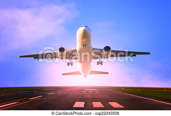 comercial passenger jet plane flying take off from airport runway