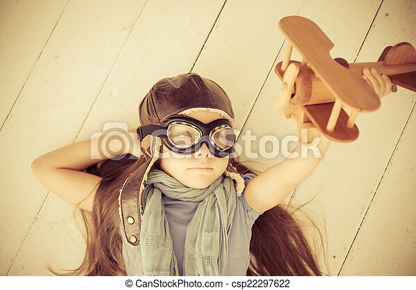 Happy child playing with toy airplane - csp22297622