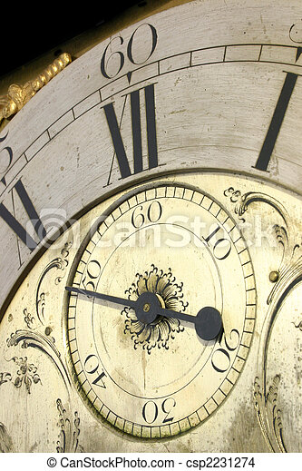 Close up of the face of an antique grandfather clock. - csp2231274