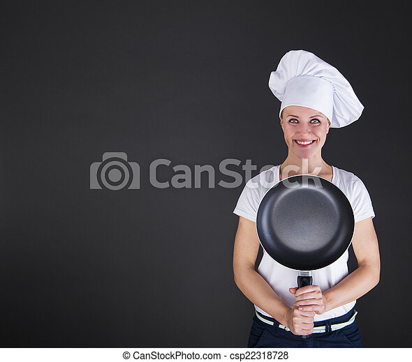 cooking and food concept - smiling female chef, cook or baker wi