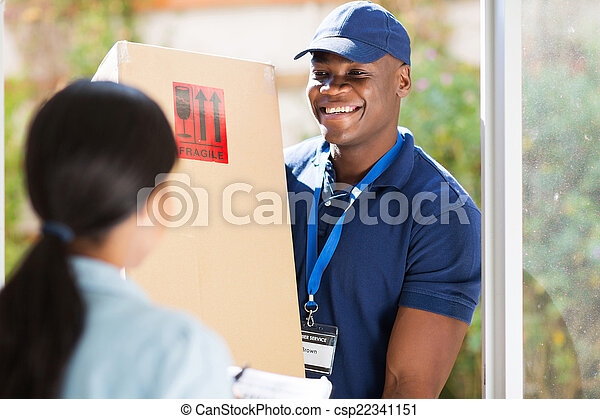 young african american delivery man delivering a package - csp22341151
