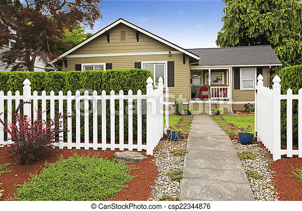 American house exterior with white wooden fence