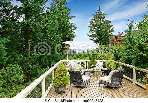 Romantic patio area on walkout deck with bay view