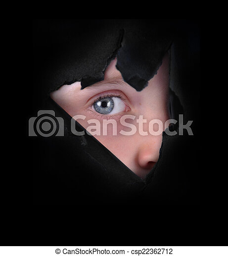 Child Peeking Through Black Paper