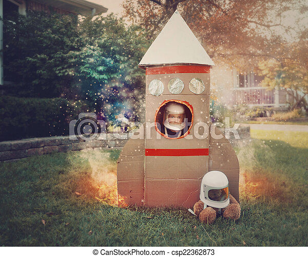 Little Boy in Cardboard Rocket Ship