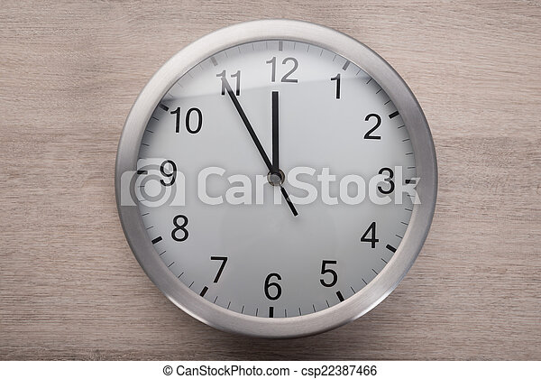 Stock Image of Clock showing five before noon