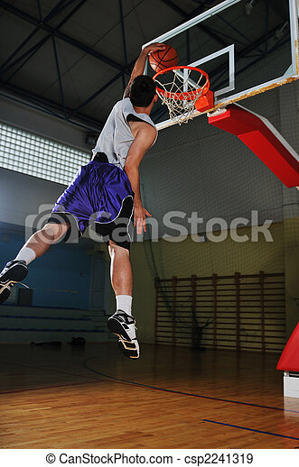 Stock Photographs of basket ball game player at sport hall - one healthy young...