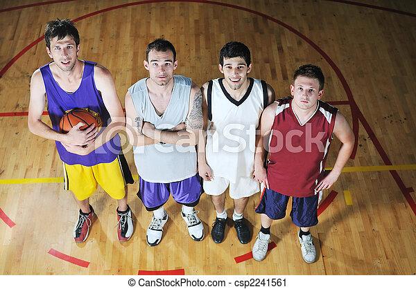 basket ball players team portrait in hi-school sport gymbasket ball players team portrait in hi-school sport gym