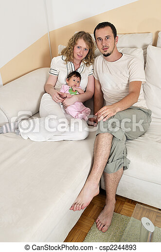 indoor portrait with happy young family and  cute little babby  - csp2244893