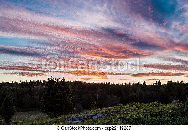 Swedish sunset over rural area - csp22449287