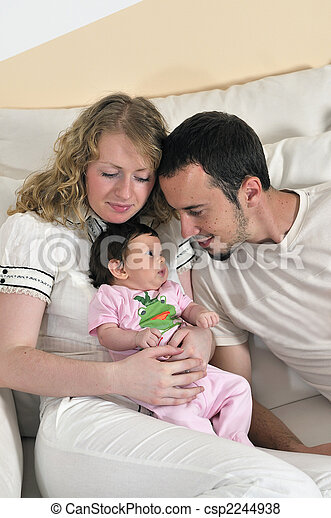 indoor portrait with happy young family and  cute little babby  - csp2244938