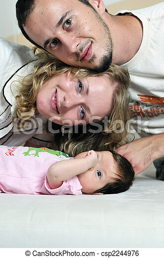 indoor portrait with happy young famil and  cute little babby  - csp2244976