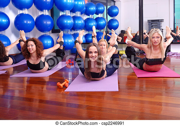 health club: women doing stretching, fitness, aerobics and yoga exercise