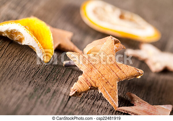 Star and oranges on the wood background