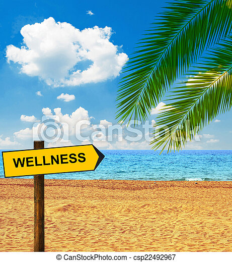 Tropical beach and direction board saying WELLNESS
