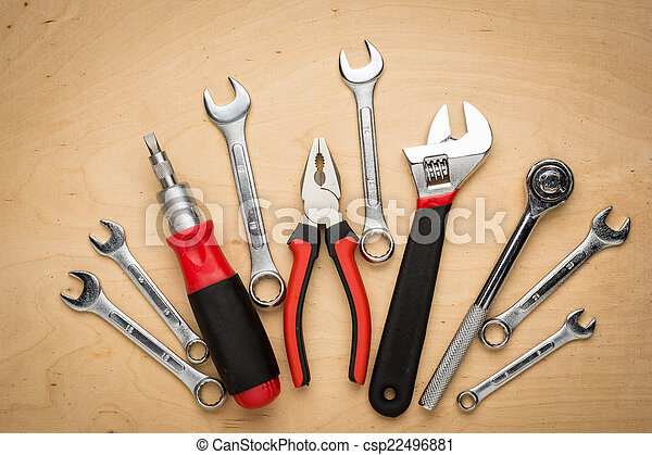 Set of hand tools on a wooden panel