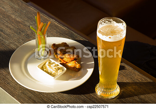 Glass of Beer and Plate of Chicken Wings