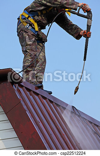Worker on top of roof - csp22512224