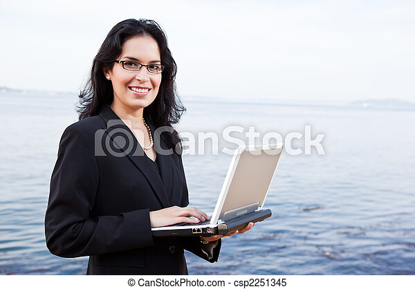 Hispanic businesswoman with laptop - csp2251345