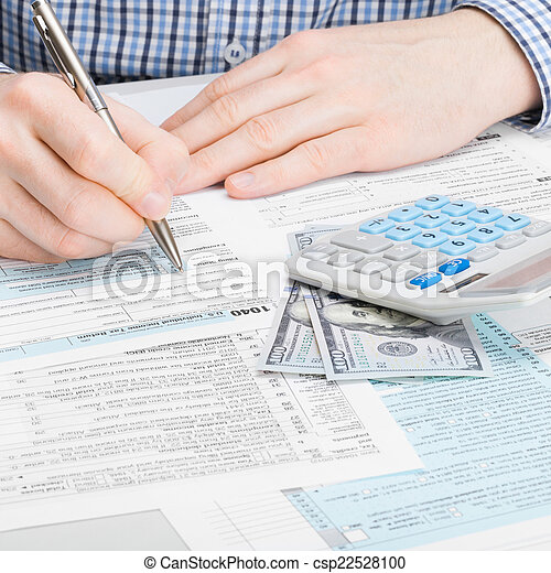 Man filling out 1040 US Tax Form - studio shot - 1 to 1 ratio
