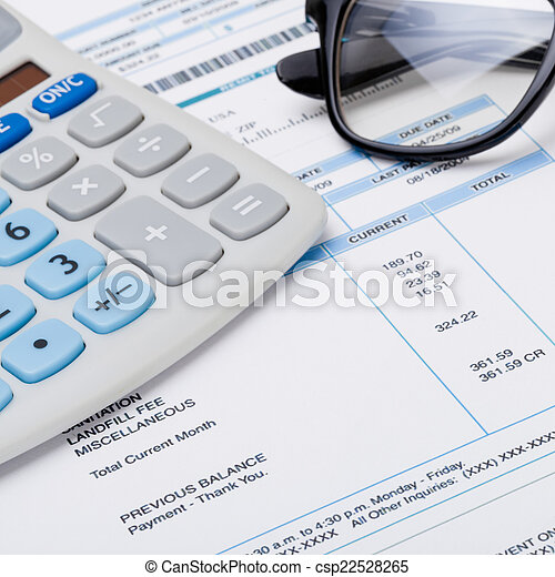 Calculator with glasses over receipt - 1 to 1 ratio