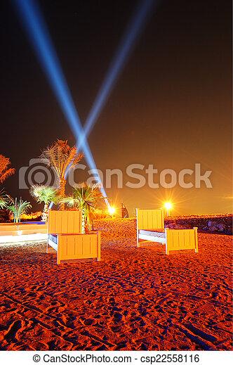 Beach of luxury hotel in night illumination on Palm Jumeirah man