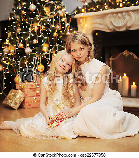 Christmas, celebration and people concept - happy family, mother