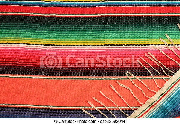 Mexico fiesta poncho rug in bright stripe background with copy space - csp22592044