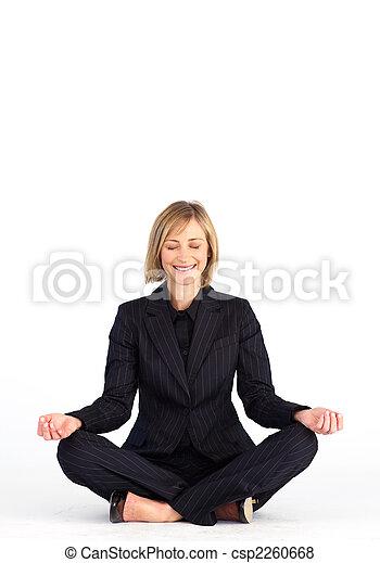 Mature businesswoman doing meditation exercises - csp2260668