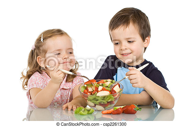Happy kids eating fruit salad - csp2261300