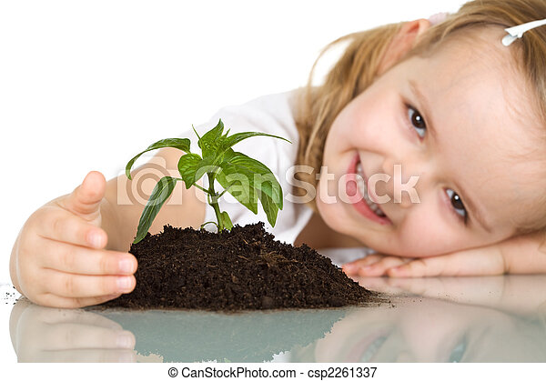 Little girl happy about her plant - csp2261337