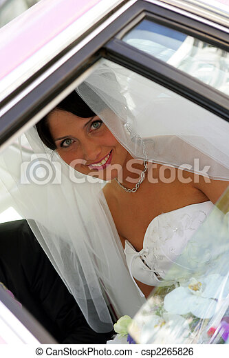 Bride smiling out of wedding car limo - csp2265826