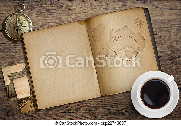 Adventure and travel nautical theme. Diary with map and compass on wooden table. - csp22743837