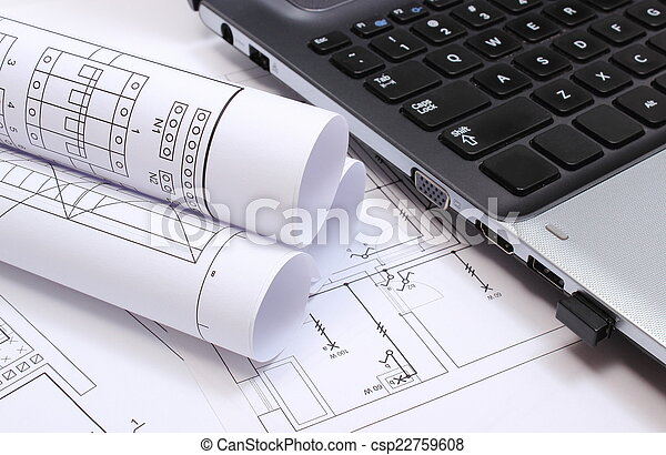 Electrical diagrams, construction drawings and laptop