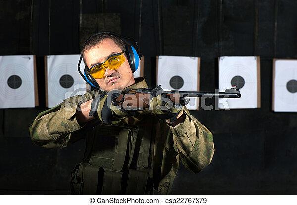 Man shooting with rifle
