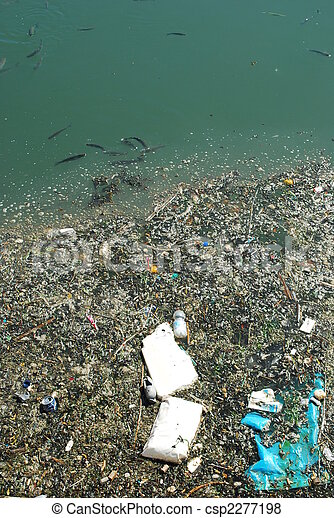 Polluted river full of rubbish and fishes - csp2277198