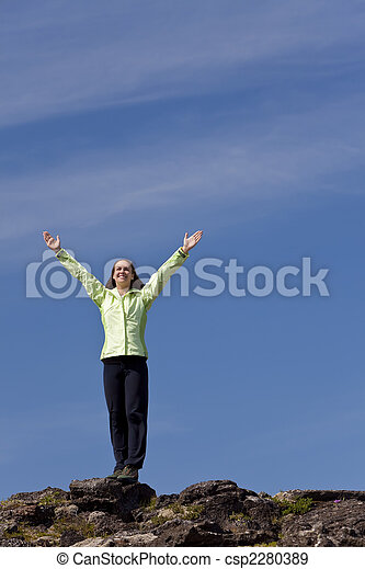 Woman Celebrating Achievement At The Top Of A Mountain - csp2280389