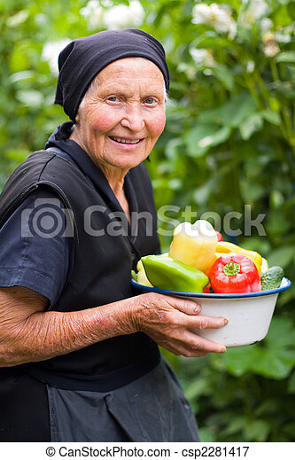 Elderly woman with vegetables - csp2281417
