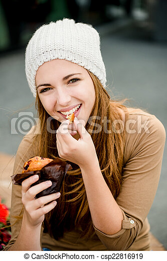 Teenager eating  muffin - csp22816919