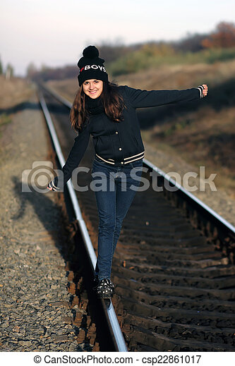 Girl walking along the old rails - csp22861017