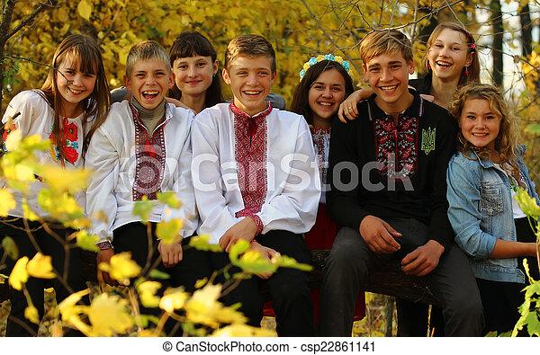 Children throw autumn leaves up - csp22861141