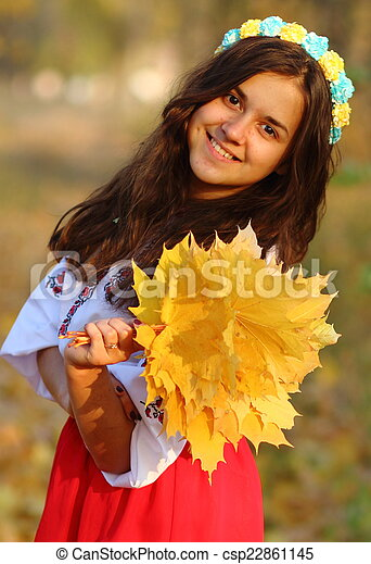 girl with a bouquet of leaves - csp22861145