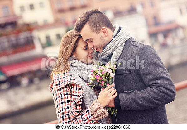 Romantic couple with flowers on a date - csp22864666