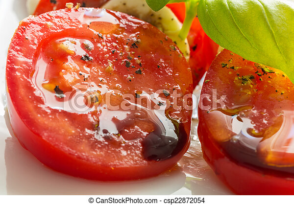Caprese salad tomato mozzarella with basil - csp22872054