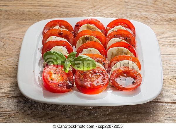 Caprese salad tomato mozzarella with basil - csp22872055