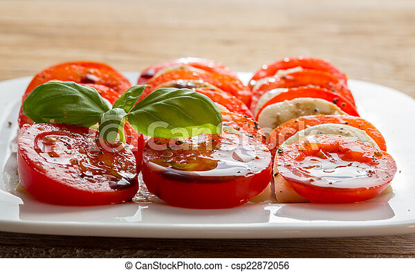 Caprese salad tomato mozzarella with basil - csp22872056