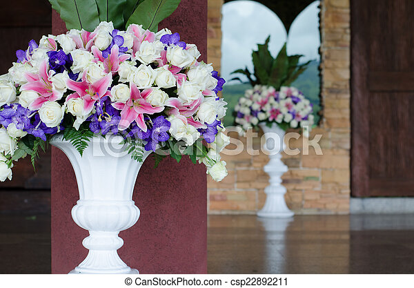 bunch of flowers in a big decorative vase