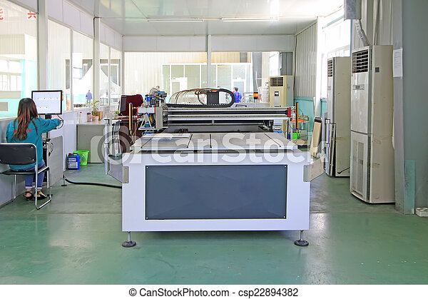 Large ink jet printers in a production workshop