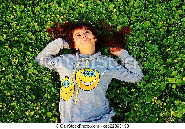 happy girl lying on the grass - csp22898133