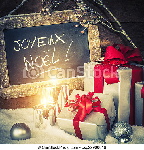 Christmas gifts with lighted candles